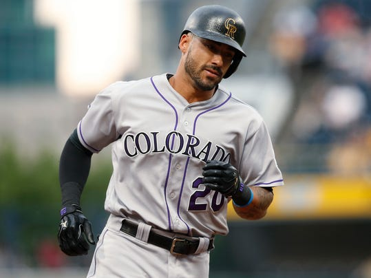 Colorado Rockies' Ian Desmond rounds third base after hitting a solo home run during the second inning against the Pittsburgh Pirates in a baseball game in Pittsburgh, Wednesday, June 14, 2017. (AP Photo/Jared Wickerham)