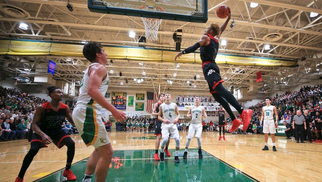 New Albany's Romeo Langford goes for the slam dunk in the second half. Highlanders' 49-47 win over New Albany in overtime Friday evening. Langford finished with 15 points. It was the Highlanders first win against New Albany since 2003.