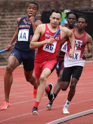 Izaiah Brown, of Rutgers, runs the second leg of the
