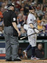Tigers second baseman Ian Kinsler has words with home