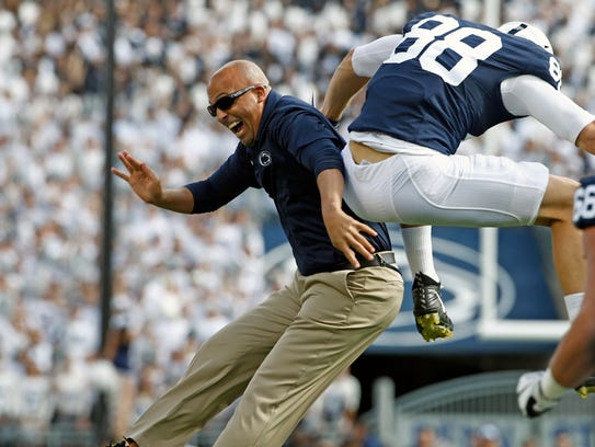 Penn State head coach James Franklin, left, celebrates