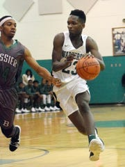 Peabody's Darius Smith (23) drives for two against Bossier.