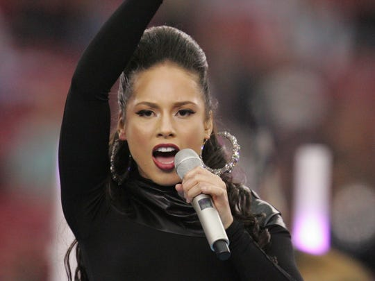 In this Feb. 3, 2008, file photo, singer Alicia Keys performs before the Super Bowl XLII football game between the New England Patriots and the New York Giants in Glendale, Ariz.