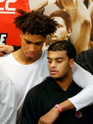 Louisville's Ray Spalding, left, and Quentin Snider