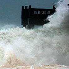 The Pensacola Beach fishing pier is drenched by waves brought by Hurricane Ivan in 2004.