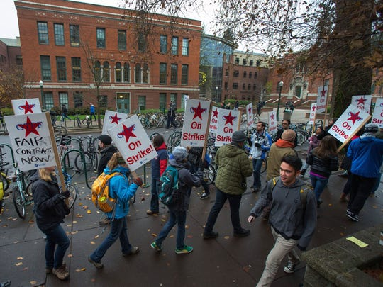 Graduate teachers and supporters march along E. 13th