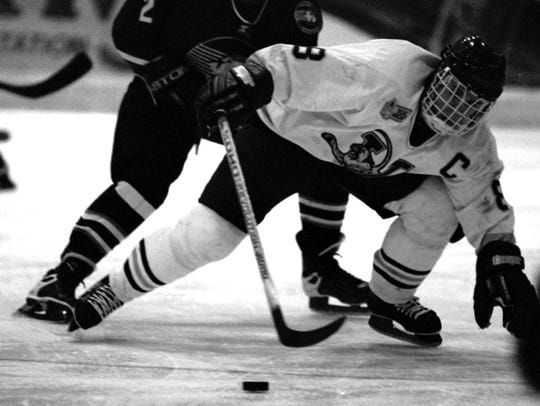 UVM's Martin St. Louis fights for control of the puck