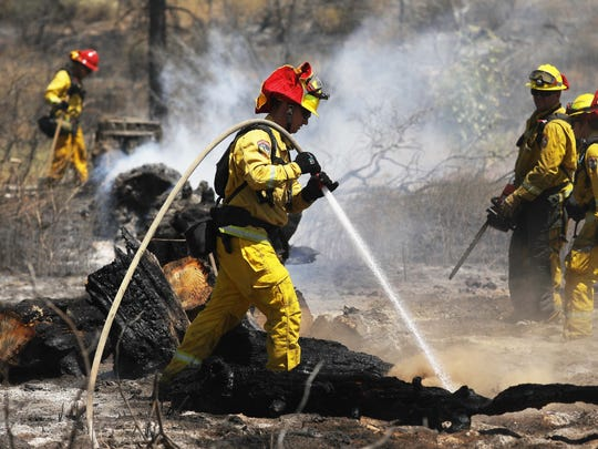 IDYLLWILD, CA - JULY 26:  Firefighters work as the Cranston Fire burns in San Bernardino National Forest on July 26, 2018 near Idyllwild, California. Fire crews are battling the 4,700-acre fire in the midst of a heat wave.  (Photo by Mario Tama/Getty Images) ORG XMIT: 775198767 ORIG FILE ID: 1005693812