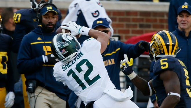 Michigan State's R.J. Shelton catches a pass for a first down gaping out of bounds in front of Jabrill Peppers in the third quarter on Saturday.