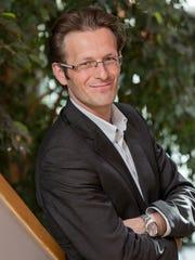 M. MaximeGambini, associate dean, marketing, development