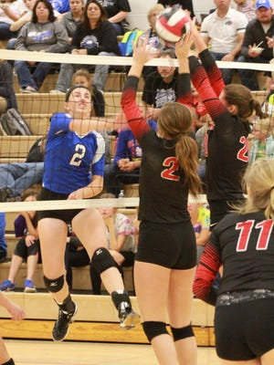 Montezuma's Hanna Jones, 2, gets a hit past two HLV defenders including Haley Coats, 2, during a Bravette 25-19, 23-25, 25-16 and 25-17 victory on Monday, Sept. 26.