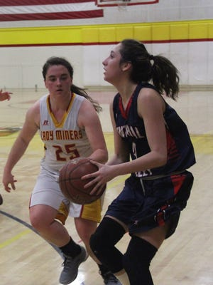 Central Valley High's Tayah Ranney, right, prepares to shoot as Yreka's Ashley Cox defends during their game in Yreka Friday night.