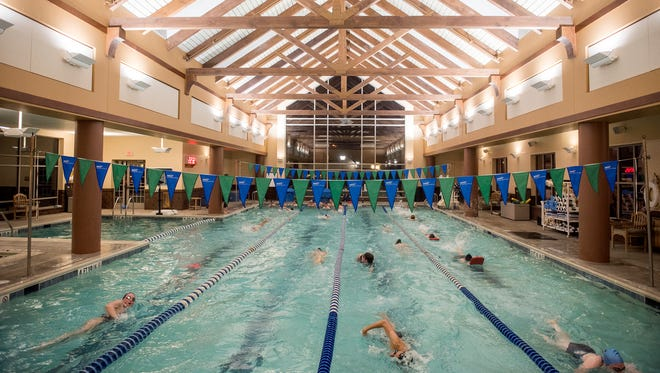 The New Oxford Colonials swim laps during their warmup, Dec. 07, 2018. The New Oxford swim team uses the wellness center pool at Cross Keys Village as their practice pool, utilizing the pool from 5 a.m. to 7 a.m.