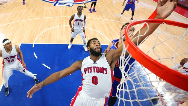 Pistons center Andre Drummond tries to tip in a rebound during the Pistons' 112-92 win Saturday at the Palace.