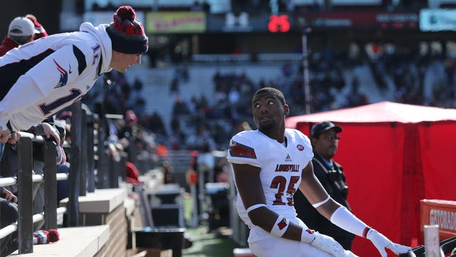 Louisville's josh Harvey-Clemons turns to face a heckler while excercising on the sideline, during the game against Boston College. Nov. 5, 2016.