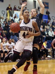 Aubrey Griffin of Ossining drives to the basket as Mariah Gonzalez of Elmira defends Friday in a Class AA state quarterfinal at Pace University in Pleasantville.
