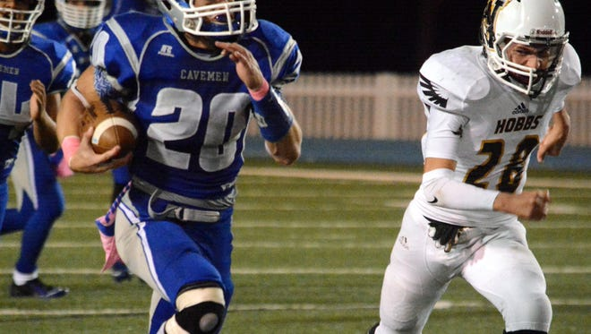 Carlsbad senior running back Luke Wood bolts down the right side for a 63-yard touchdown run in the third quarter last Friday against Hobbs.