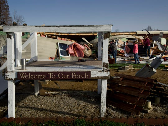 The porch of the Fort Branch, Ind., home of Josh Brewer and Jackie Thorne was left standing, but the mobile home was rolled onto it's roof in last night's strong storms.