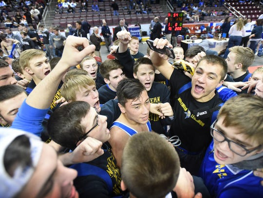 The Northern Lebanon Viking wrestlers huddle after
