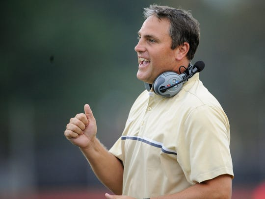 Former Central Head Coach Andy Owen cheers during a game against Paoli at Central Stadium.