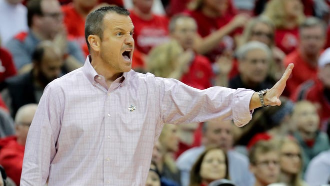 Louisville's Jeff Walz instructs his team from the sidelines.