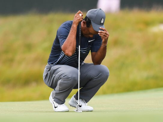 Tiger Woods reacts on the sixteenth green during the