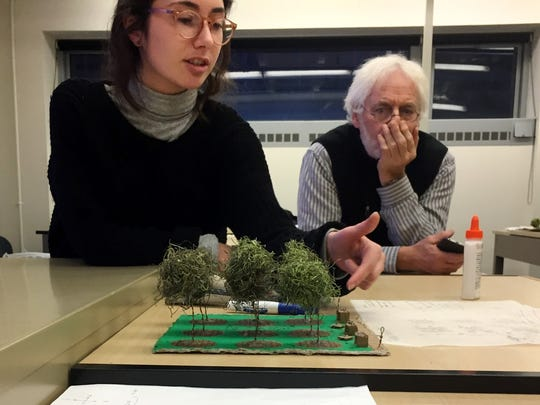 Katherine Talvacchia, a UVM design student, discusses her model showing upgrades to the park beside Cathedral of the Immaculate Conception in Burlington. Her instructor, MIddlebury-based landscape designer David Raphael, listens. Photographed Dec. 7, 2017.