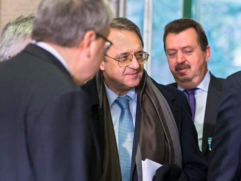 Russian Deputy Foreign Minister Mikhail Bogdanov, center, arrives for a meeting to  find a solution to the crisis in Syria, at the European U.N. headquarters in Geneva, Switzerland, on Nov. 25, 2013.