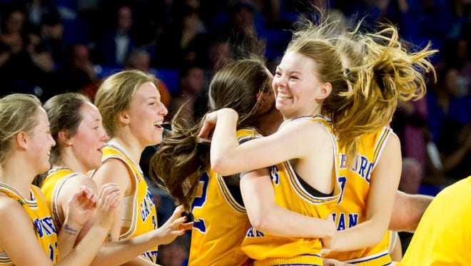 The Gatlinburg-Pittman girls basketball team celebrates after defeating Westview in the quarterfinals of the Class AA state tournament at the Murphy Center in Murfreesboro on Thursday.