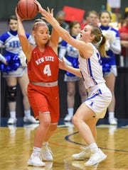 New Site's Libby Loden (4) tries to solve the defense of Lindsay Hall of Ingomar during the MHSAA Girls 2A Championship Game held at The Coliseum in Jackson MS.(Photo/Bob Smith)