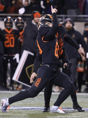 Massillons kicker Alex Bauer celebrates with holder Zach Catrone after hitting a field goal to go up 17 -14 over Hoban in the first half of last year's Division II regional final.