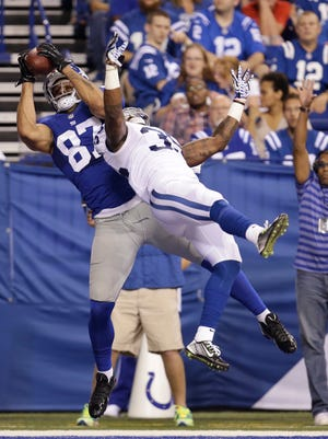 Kellen Davis makes a 3-yard touchdown reception against Indianapolis Colts defensive back David Sims while with the New York Giants during a preseason game on Aug. 16, 2014. The former Lion and Michigan State alum has signed with the New York Jets.