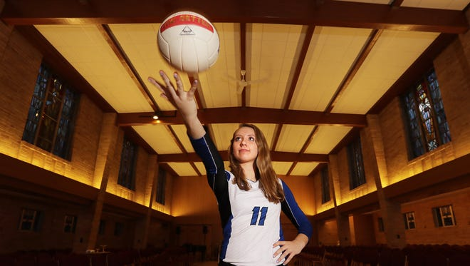 Green Bay Notre Dame senior Corinne Meglic is the Green Bay Press-Gazette's girls volleyball player of the year. Meglic is shown in the chapel at Notre Dame on December 1, 2016.