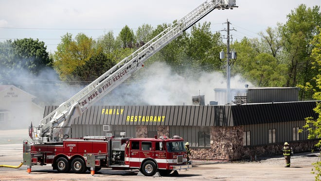Multiple area fire departments responded to a structure fire on Elmview Road on Wednesday in Ledgeview.   Adam Wesley/USA TODAY NETWORK-Wisconsin
