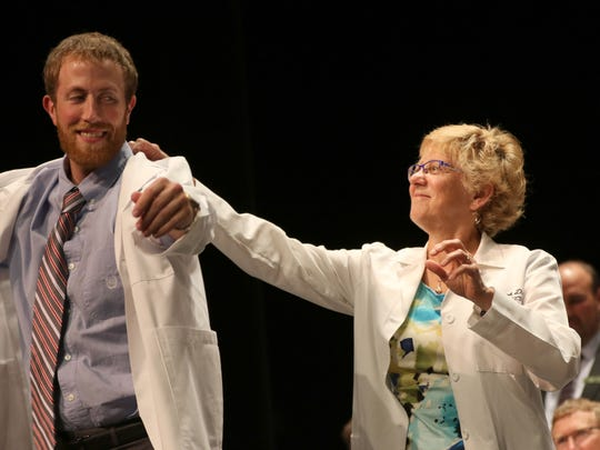 Connor Harmann is coated during the Medical College of Wisconsin Central Wisconsin White Coat Ceremony at UW Marathon County, in Wausau, Wisconsin, July 7, 2016.