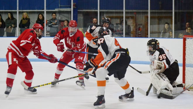 Mamaroneck goalie Tommy Spero gloves a shot from Bryan Jensen during the first period of the Tigers' 3-1 semifinal win over North Rockland on Friday at Hommocks Park Ice Rink.