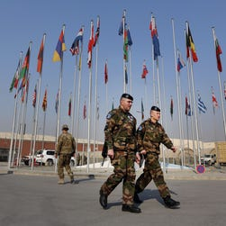 French soldiers leave a NATO handover ceremony at the Hamid Karzai Airport, in Kabul, Afghanistan, on  Dec. 31, 2014.