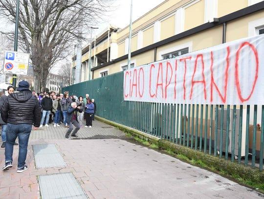 "A giant banner reading ""Ciao Captain"" (goodbye captain)"