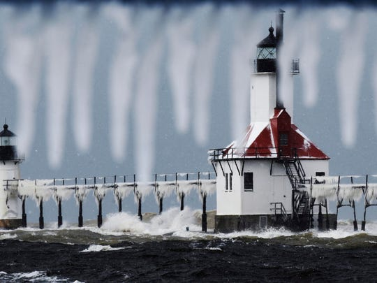 Snow and ice accumulate on the St. Joseph Lighthouse as a fall snowstorm moves through St. Joseph, Mich., on Nov. 12.