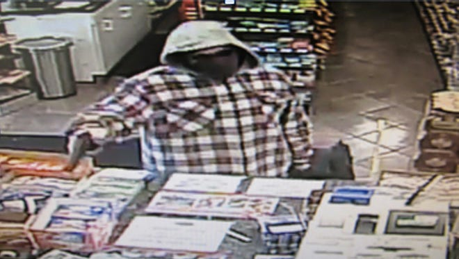 Store camera at Durkin's, a Beacon convenience store, shows a thief sticking up the clerk for cash Monday afternoon about 3 p.m.