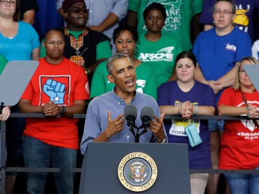President Obama speaks at Laborfest 2014 at Henry Maier Festival Park Monday, Sept. 1, 2014, in Milwaukee. (AP Photo/Morry Gash)