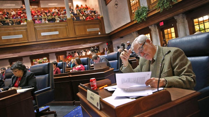 Sen. Jim Arnold, right, in the Indiana Senate chambers on Jan. 27.