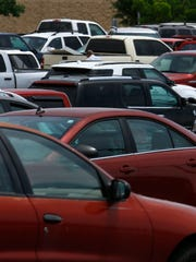 Cars fill a parking lot on Monday at a shopping center near East Main Street in Farmington. Police are asking Farmington residents to lock their cars to protect themselves against thieves.