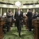 Gov. Jerry Brown is applauded by lawmakers as he walks down the center aisle of the Assembly chambers to give his annual State of the State address to a joint session of the Legislature, Thursday, Jan. 21, 2016, in Sacramento.