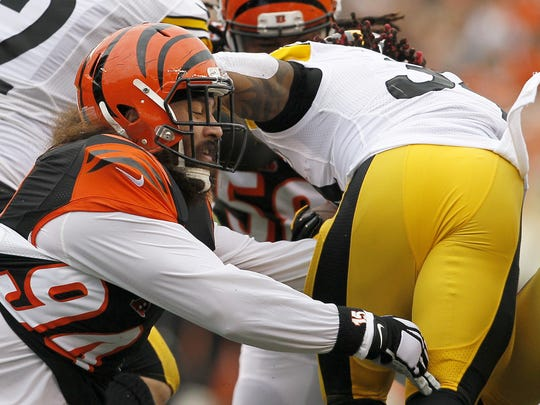 Cincinnati Bengals defensive tackle Domata Peko (94) gets a grip on Pittsburgh Steelers running back DeAngelo Williams (34) in the first quarter of the NFL Week 14 game between the Cincinnati Bengals and the Pittsburgh Steelers at Paul Brown Stadium in downtown Cincinnati on Sunday, Dec. 13, 2015. At the half, the Steelers led 16-7.