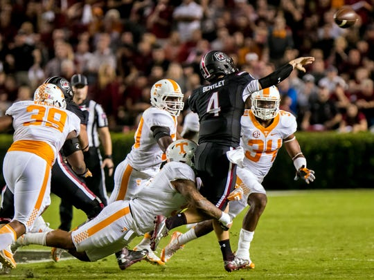 Oct 29, 2016; Columbia, SC, USA; South Carolina Gamecocks quarterback Jake Bentley (4) throws under pressure from Tennessee Volunteers defensive lineman Kendal Vickers (39) in the first quarter at Williams-Brice Stadium. Mandatory Credit: Jeff Blake-USA TODAY Sports