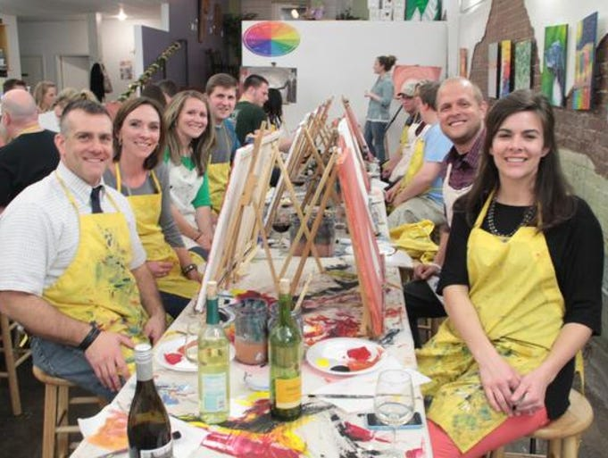 RSVPaint in downtown Springfield has a variety of painting classes including some specifically aimed at couples, like this one. It's a great date night idea, said John Coleman, general manager.