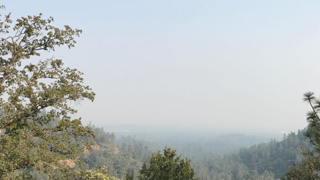 Smoke hangs thick over the Redding area last week, as seen from Highway 151, which is the road to Shasta Dam. Whiskeytown officials have urged visitors not to boat on the lake because of low visirbility due to smoke on the water.