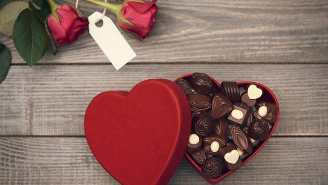 Roses and opened chocolate box