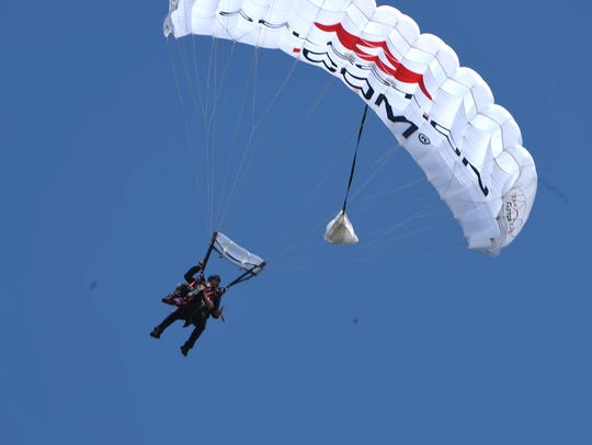 U.S. Army Staff Sgt. Stephen Valyou parachutes to his